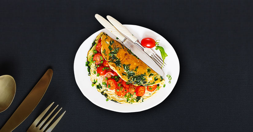 Herby Omelette with Smashed Tomatoes